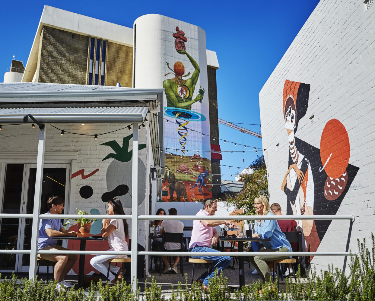 Casual dining, Northbridge cafe with local Urban art in the background.