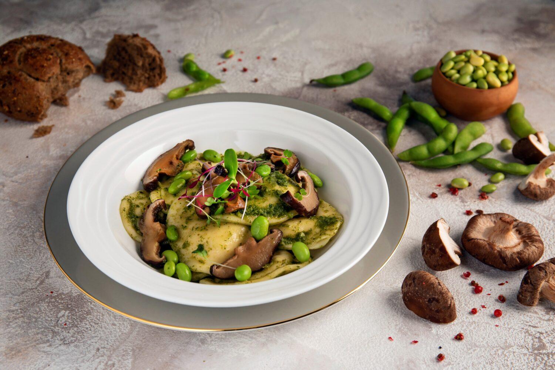 Shitake Ravioli served with coriander pesto and edamame